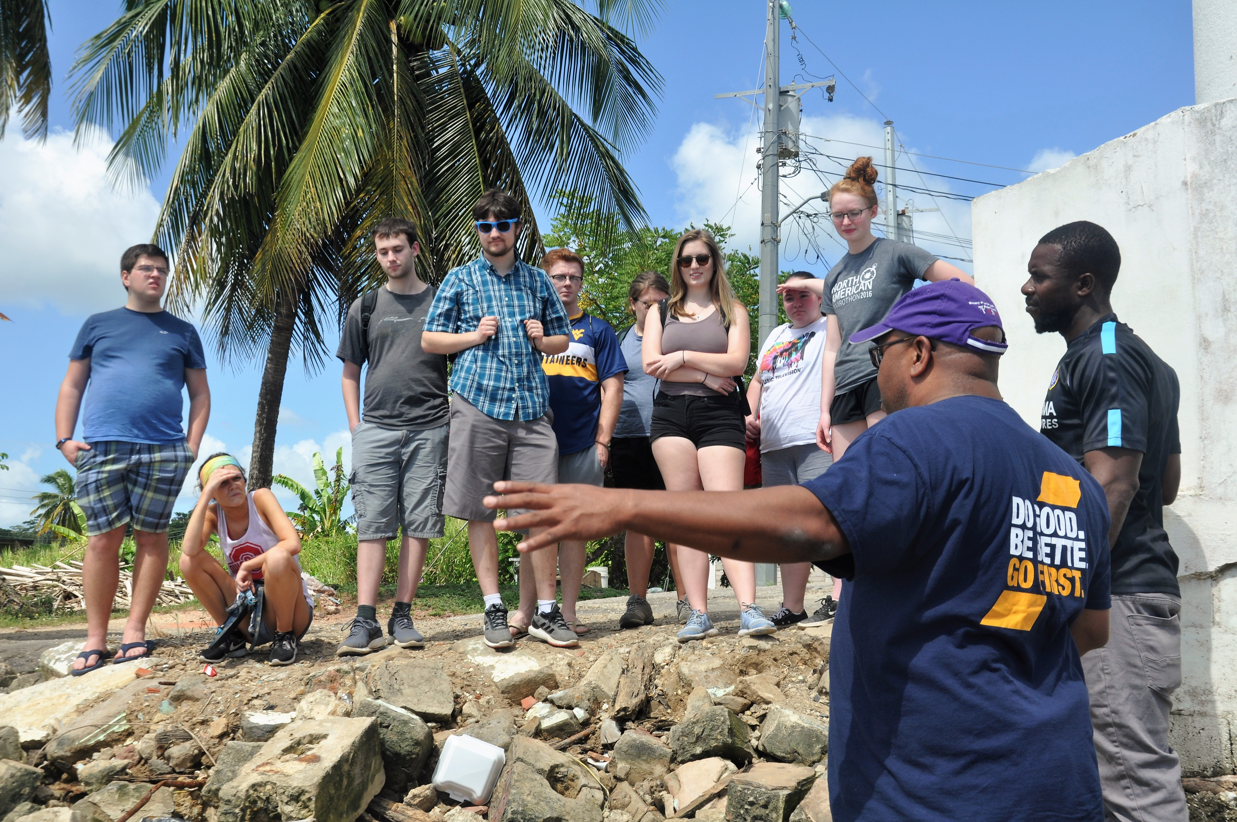 Student learning about the local community and environment from a WVU professor.